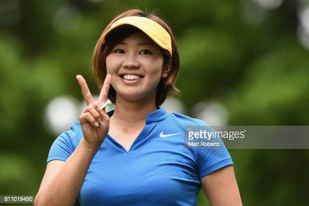 Rumi Yoshiba of Japan reacts after her tee shot on the 8th hole during the final round of the Nipponham Ladies Classics at the Ambix Hakodate Club on...