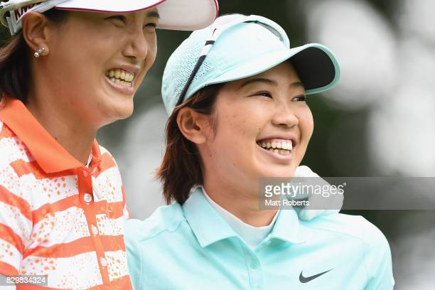 Rumi Yoshiba of Japan shares a laugh with MiJeong Jeon of South Korea during the first round of the NEC Karuizawa 72 Golf Tournament 2017 at the...