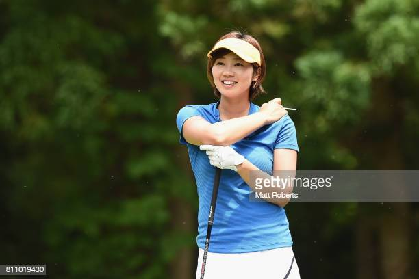 Rumi Yoshiba of Japan smiles after her tee shot on the 8th hole during the final round of the Nipponham Ladies Classics at the Ambix Hakodate Club on...