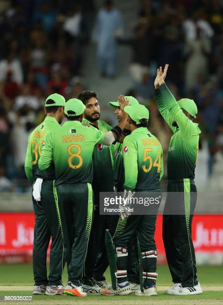 Rumman Raees of Pakistan celebrate with teammates after dismissing Niroshan Dickwella of Sri Lanka during the first One Day International match...