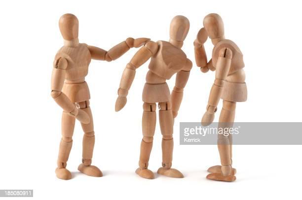 Rumors - wooden mannequin wispering