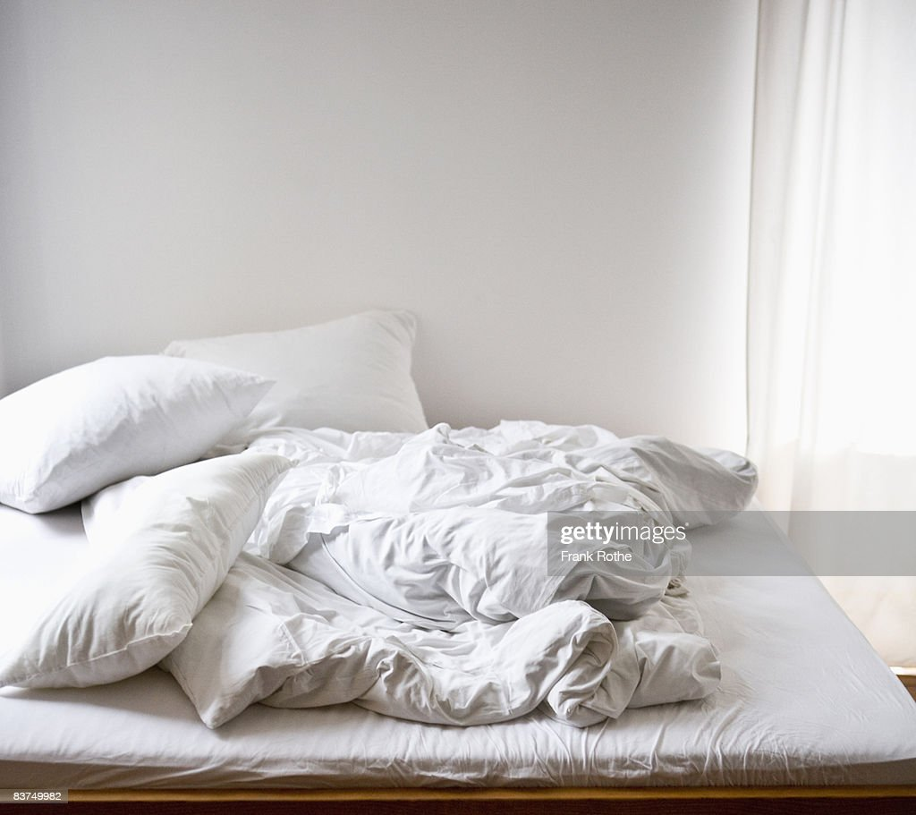 rumpled bedclothes : Stock Photo