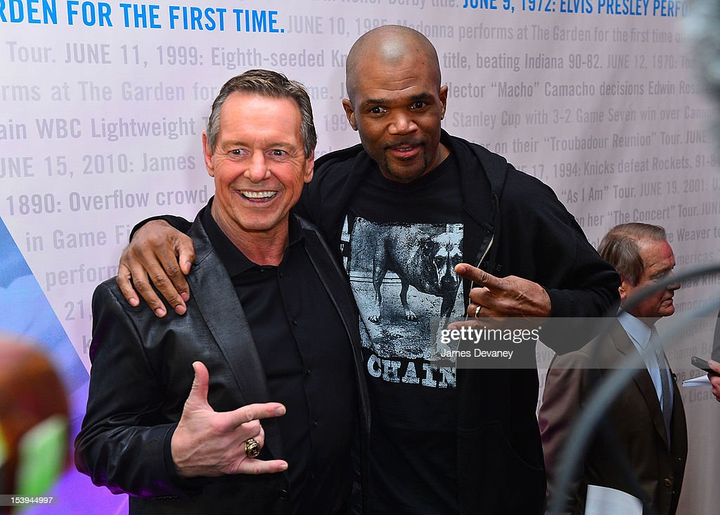 Run DMC <a gi-track='captionPersonalityLinkClicked' href=/galleries/search?phrase=Darryl+McDaniels&family=editorial&specificpeople=175934 ng-click='$event.stopPropagation()'>Darryl McDaniels</a> and WWE Hall of Famer ÒRowdyÓ Roddy Piper (L) attends Madison Square Garden's 'Garden 366' And 'Defining Moments' Exhibition Openings at Madison Square Park on October 11, 2012 in New York City.