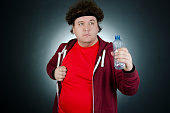 Funny fat guy. Fitness and gym. Studio. Body care and a healthy lifestyle.