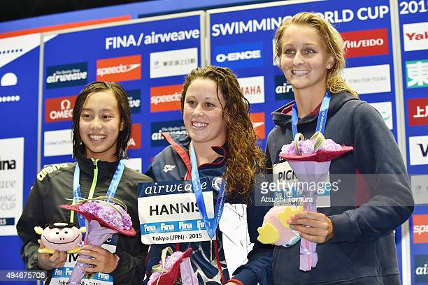 Runa Imai of Japan Molly Hannis of the USA and Leiston Pickett of Australia pose on the podium after the Women's 100m Breaststroke final during the...
