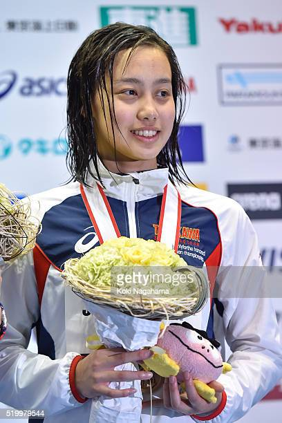 Runa Imai poses for pgotographs on the podium after the Women's 200m Breaststroke final during the Japan Swim 2016 at Tokyo Tatsumi International...