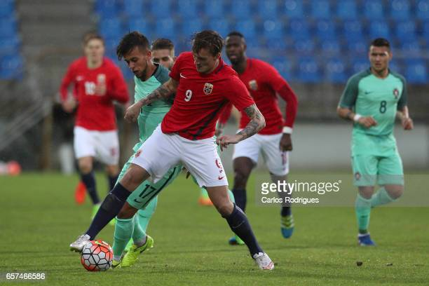 Runar Espejord of Norway vies with Portugal's midfielder Francisco Ramos during the match between Portugal v Norway U21 International Friendly match...
