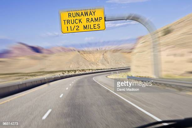 Runaway truck sign on highway.
