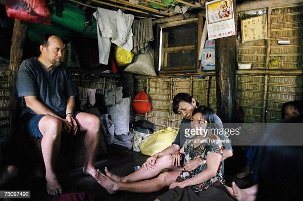 Rundell and Judi Maree visit a sick woman Alma Eleinia who has suffered from Polio since childhood is now in advance stages of Malaria on June 1 2004...