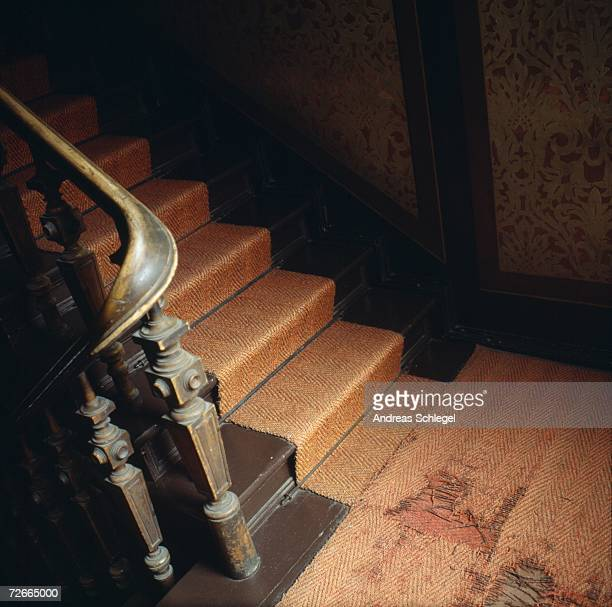 Run-down landing and stairs in apartment building