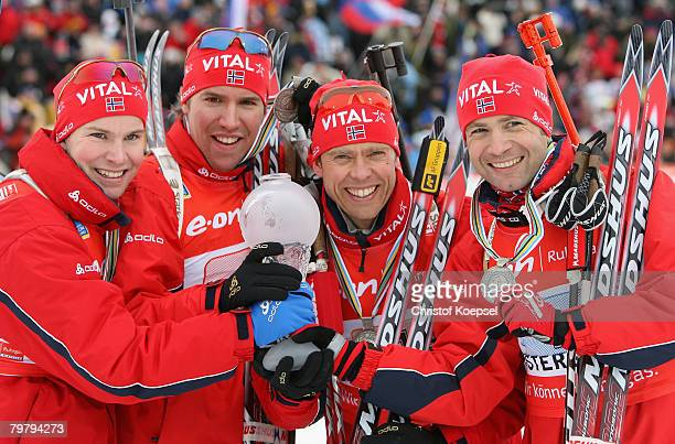 Rune Bratsveen Emil Hegle Svendsen Halvard Hanevold and Ole Einar Bjoerndalen of Norway present the silver medal and their trophy of winning the...