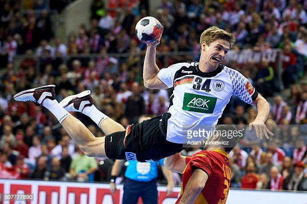 Rune Dahmke from Germany throws the ball against Gedeon Guardiola from Spain during the Men's EHF Handball European Championship 2016 Final match...