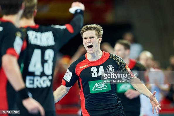 Rune Dahmke of Germany celebrates after scoring during the Men's EHF Handball European Championship 2016 match between Germany and Denmark at...