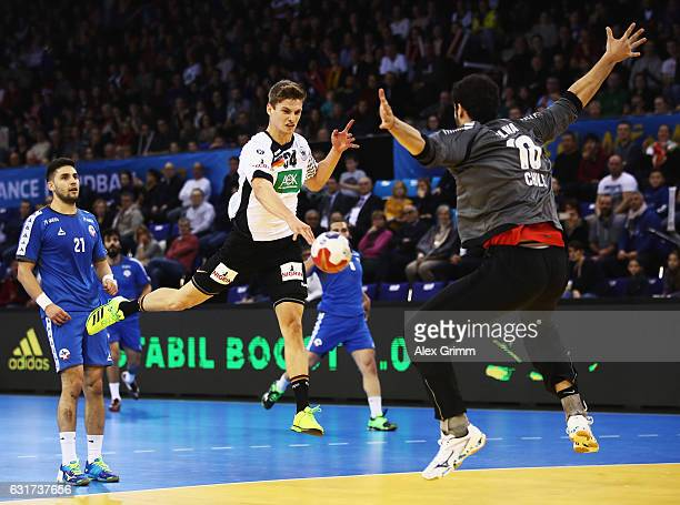 Rune Dahmke of Germany throws a goal during the 25th IHF Men's World Championship 2017 match between Chile and Germany at Kindarena on January 15...
