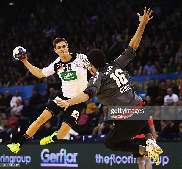 Rune Dahmke of Germany throws a goal past Rene Oliva of Chile during the 25th IHF Men's World Championship 2017 match between Chile and Germany at...