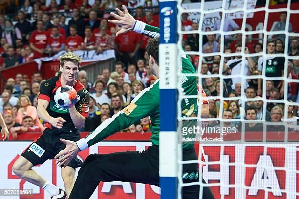 Rune Dahmke of Germany throws the ball against goalkeeper Niklas Landin Jacobsen of Denmark during the Men's EHF Handball European Championship 2016...