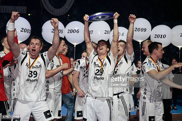 Rune Dahmke of Kiel celebrate with the trophy after the DKB HBL Bundesliga match between THW Kiel and TBV Lemgo at Sparkassen Arena on June 5 2015 in...