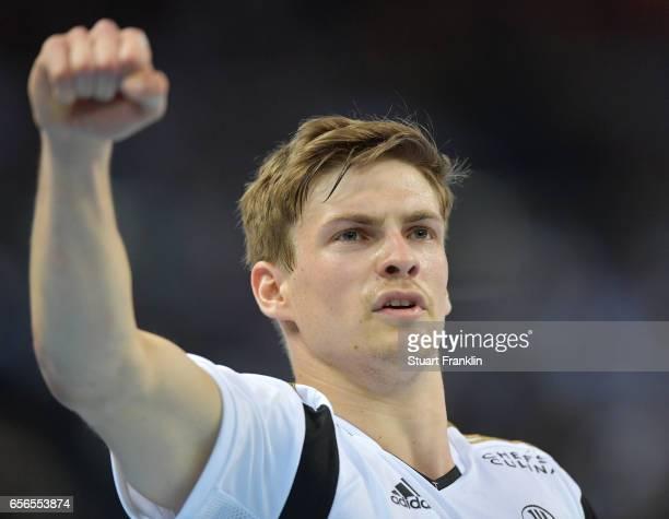 Rune Dahmke of Kiel celebrates during the first leg round of 16 EHF Champions League match between THW Kiel and Rhein Neckar Loewen at Sparkassen...