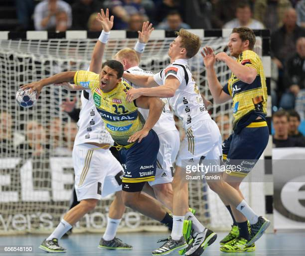 Rune Dahmke of Kiel is challenged by Mads Mensah Larsen of Rhein Neckar during the first leg round of 16 EHF Champions League match between THW Kiel...