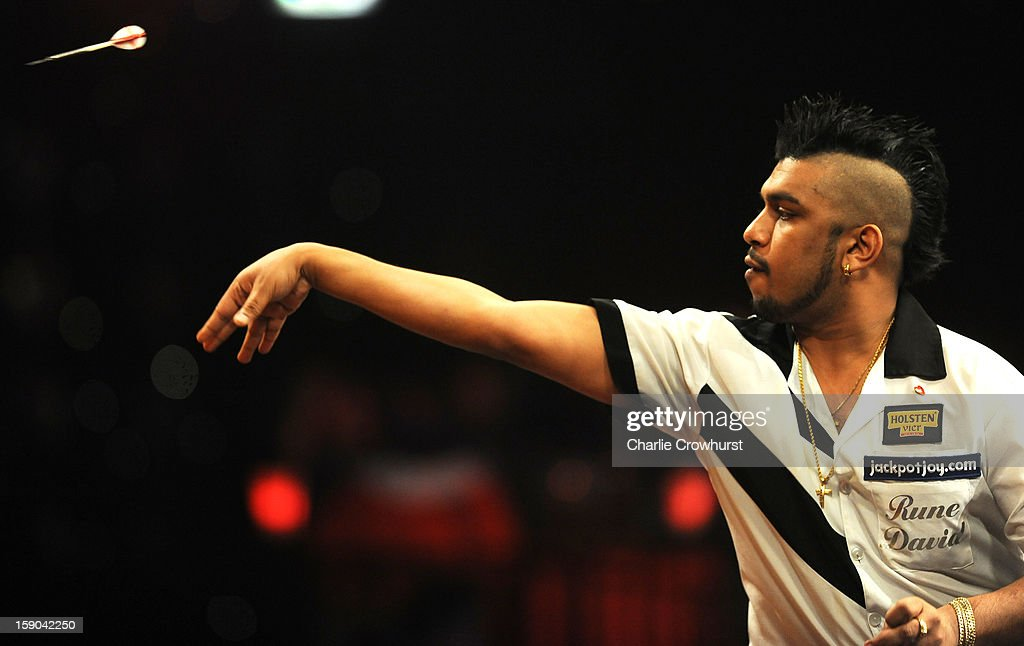 Rune David of Norway in action during his first round match against Wesley Harms of The Netherlands on day two of the BDO Lakeside World Professional Darts Championships at Lakeside Country Club on January 06, 2013 in London, England.