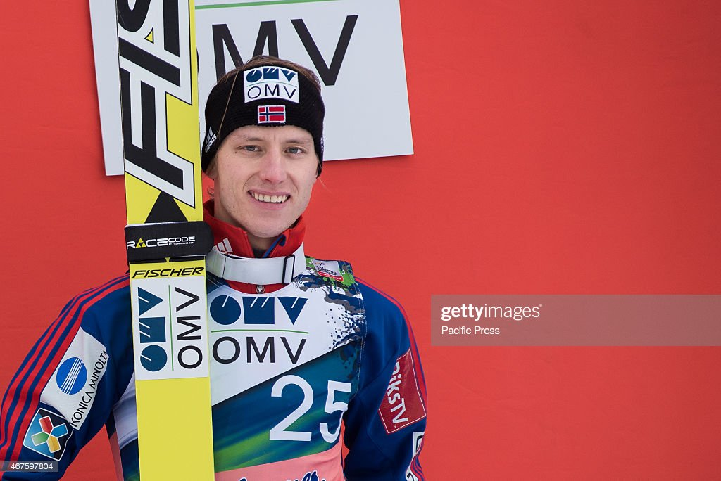 <a gi-track='captionPersonalityLinkClicked' href=/galleries/search?phrase=Rune+Velta&family=editorial&specificpeople=6845746 ng-click='$event.stopPropagation()'>Rune Velta</a> of Norway on podium celebrating his third place at FIS World Cup Planica Ski Jumping finals.