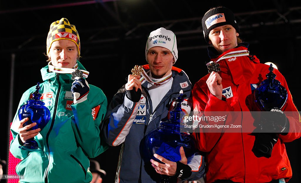 Rune Velta of Norway takes 2nd place, <a gi-track='captionPersonalityLinkClicked' href=/galleries/search?phrase=Robert+Kranjec&family=editorial&specificpeople=722812 ng-click='$event.stopPropagation()'>Robert Kranjec</a> of Slovenia takes 1st place, and <a gi-track='captionPersonalityLinkClicked' href=/galleries/search?phrase=Martin+Koch&family=editorial&specificpeople=723524 ng-click='$event.stopPropagation()'>Martin Koch</a> of Austria takes 3rd place during the FIS Ski Flying World Championships HS225 on February 25, 2012 in Vikersund, Norway.