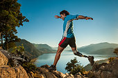 Disabled man with prosthetic leg, runing in Patagonia.