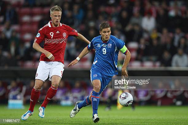 Runk Gislason of Iceland and Nicolai Jorgensen during the UEFA European Under21 Championship Group A match between Iceland and Denmark at the Aalborg...