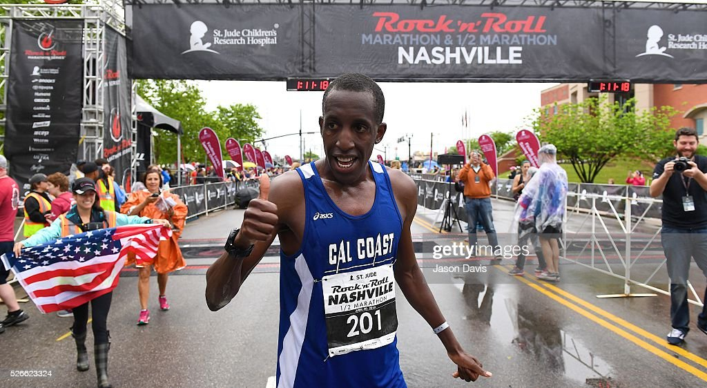 Runner and 3 time half-marathon winner; Roosevelt Cook celebrates as he crosses the finish-line in the St. Jude Rock 'n' Roll Nashville Marathon/Half Marathon and 5k where more than 34,000 participants weathered the rain during the 17th running on April 30, 2016 in Nashville, Tennessee.