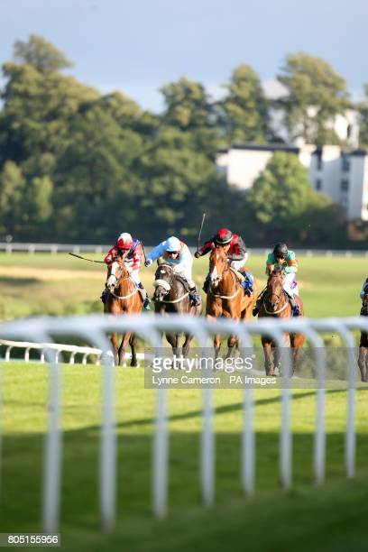 Runner and riders in the Racing UK Auction Nursery Handicap make their way up the home straight at Hamilton Race Course