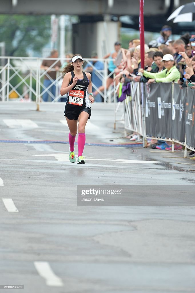 Runner and woman's marathon winner Melanie Kulesz celebrates as she crosses the finish-line in the St. Jude Rock 'n' Roll Nashville Marathon/Half Marathon and 5k where more than 34,000 participants weathered the rain during the 17th running on April 30, 2016 in Nashville, Tennessee.