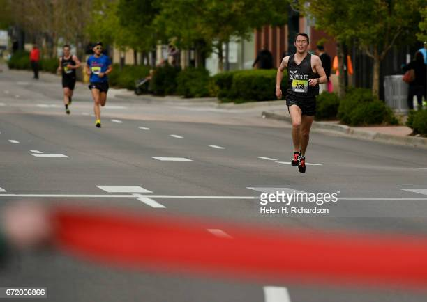 Runner Andrew Monaghan right of Denver closes in on the finish line with his competitors in hot pursuit during the 35th annual Cherry Creek Sneak 10...