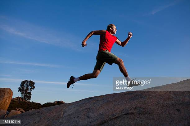 Runner at dusk on a mountain range