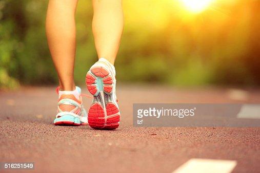 Runner athlete legs : Stock Photo