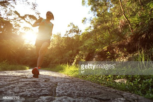 Runner athlete running on forest trail. : Stock Photo