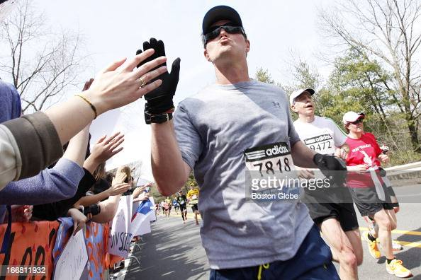 Runner blew a kiss back to the scream tunnel Students are known to hold signs up soliciting kisses to runners The 117th Annual Boston Marathon makes...