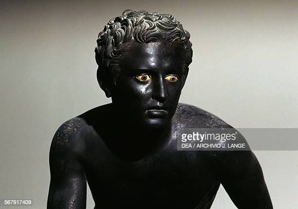 Runner bronze sculpture from Villa of the Papyri Herculaneum Campania Italy Roman civilisation 1st century BC Naples Museo Archeologico Nazionale