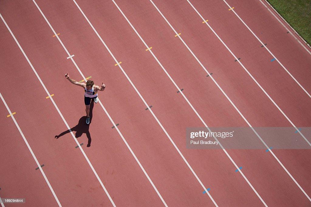 Runner cheering on track : Stock Photo
