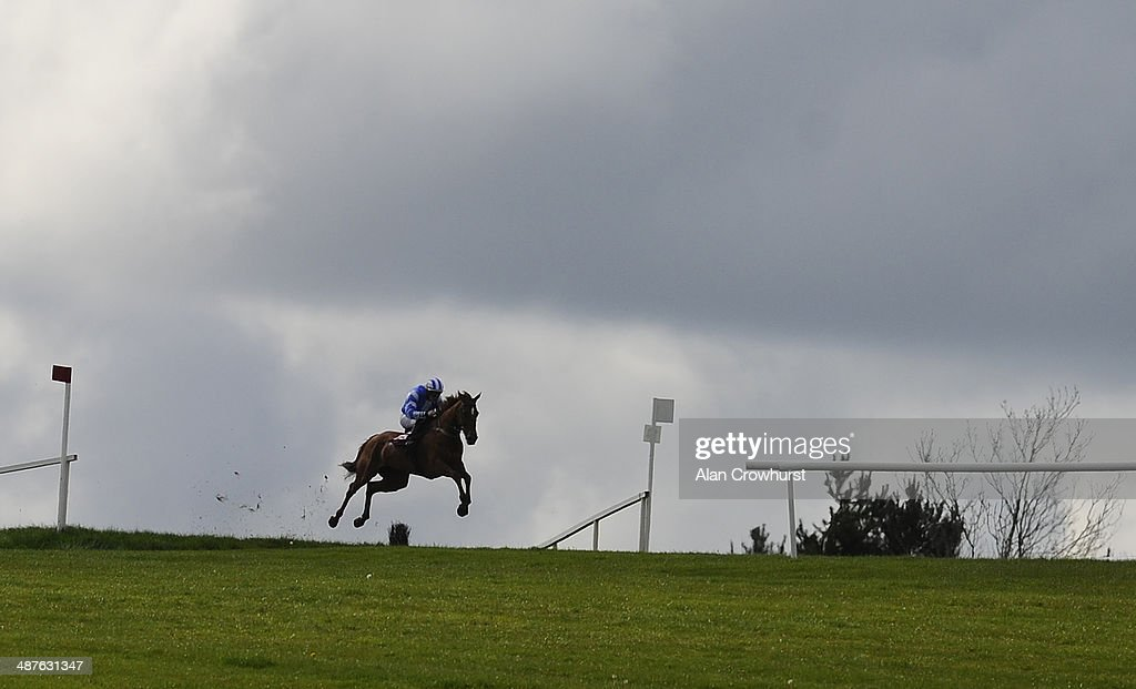 A runner claers the Drop Bank in The Avon Ri Corporate & Leisure Resort Chase For The La Touche Cup at Punchestown racecourse on May 01, 2014 in Naas, Ireland.