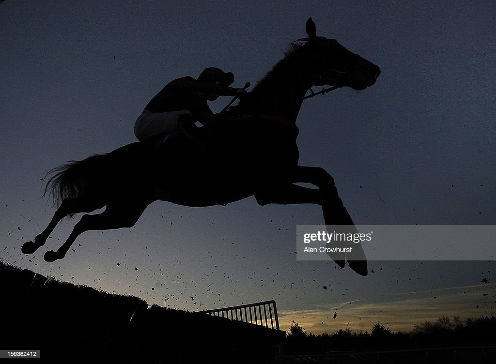 A runner clears a flight of hurdles at Exeter racecourse on November 14, 2012 in Exeter, England.
