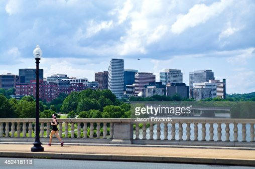 A runner crosses the Arlington Memorial Bridge over the Potomac River.