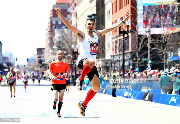 A runner crosses the finish line during the 120th Boston Marathon on April 18 2016 in Boston Massachusetts