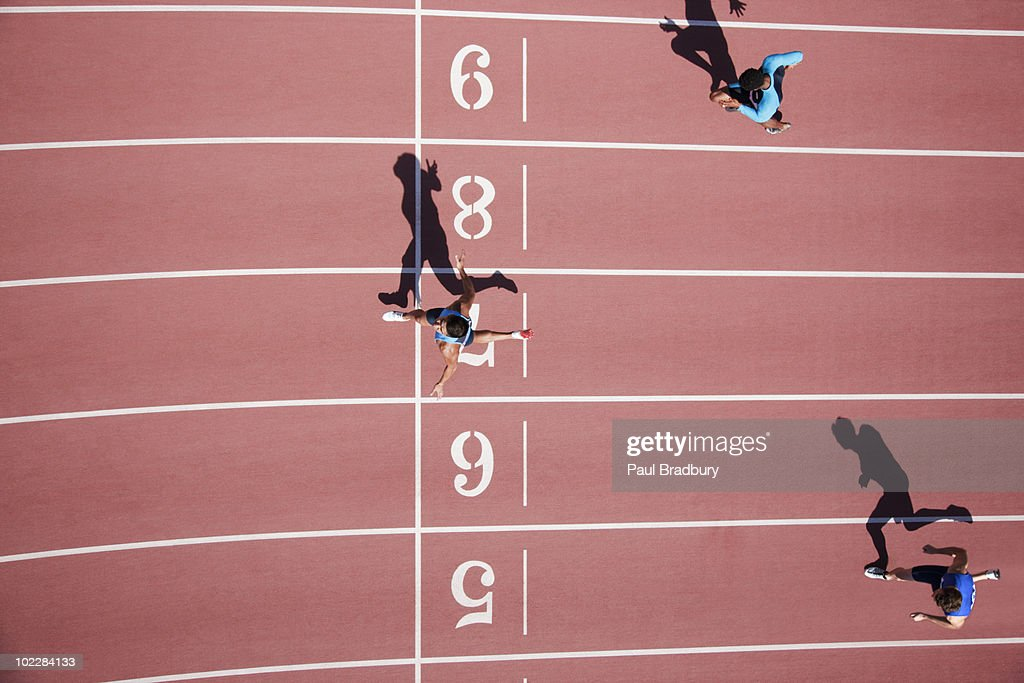 Runner crossing finishing line on track : Stock Photo
