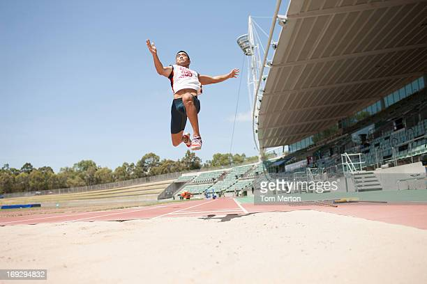Runner doing long jump