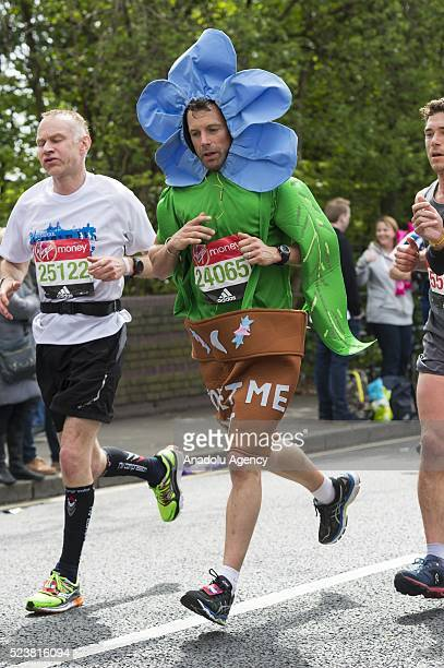 A runner dressed as flower pot plant takes part in the 2016 London Marathon in London United Kingdom on April 24 2016