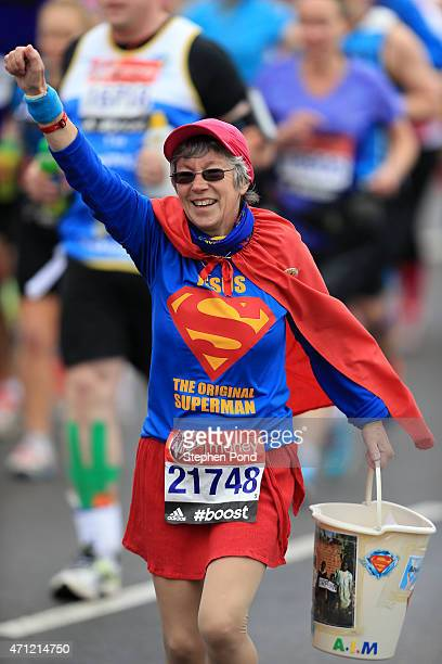 A runner dressed as Superman in the mass start during the Virgin Money London Marathon on April 26 2015 in London England