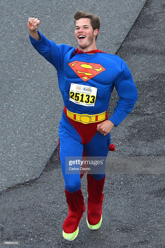A runner dressed as Superman on Yonge Street south of Davisville Avenue. Runners lace up their sneakers and hit the pavement for the 17th annual Sporting Life Run on Mother's Day. The run started at 8 a.m. at Yonge Street and Roselawn Avenue, and the finish line is just west of Bathurst on Ford York Blvd. The run raises money for Camp Oochigeas which helps kids with cancer attend summer camp.