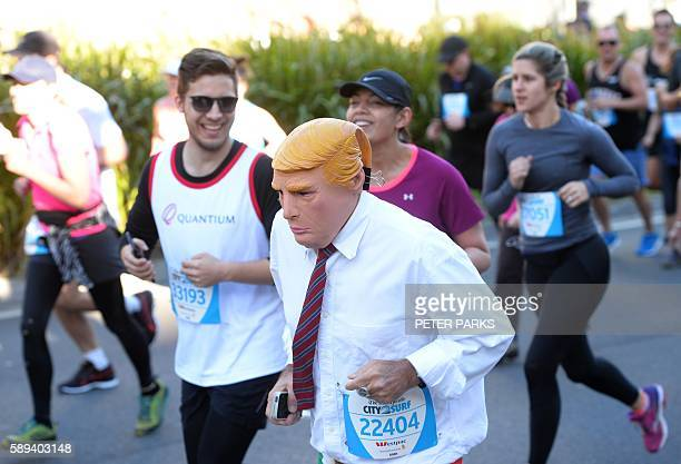 A runner dressed as US presidential candidate Donald Trump takes part in the annual City2Surf road race in Sydney on August 14 2016 Local distance...