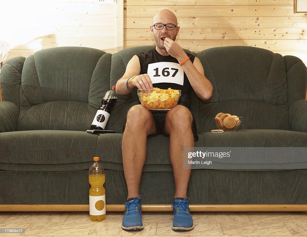 Runner eating chips on sofa