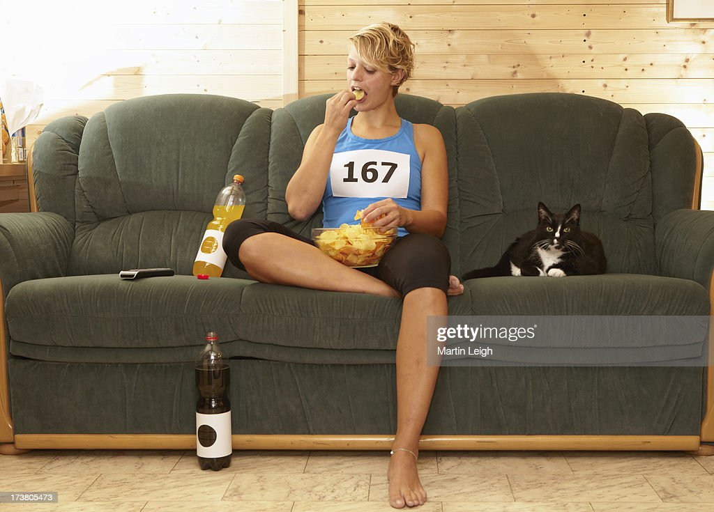 Runner Eating Chips On Sofa Stock Photo Getty Images